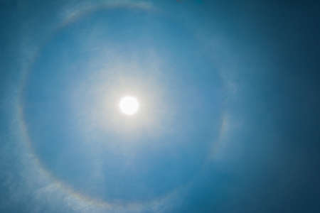 gloriole: image of sun be encircled by a halo. Stock Photo