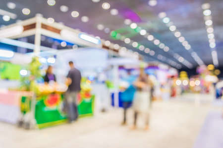 exhibition crowd: blurred image of shopping mall and people for background usage . Stock Photo