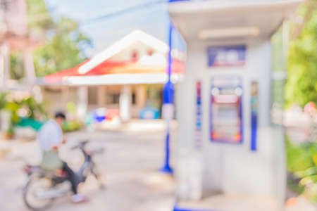 automatic teller machine: blur image of automatic teller machine on day time .