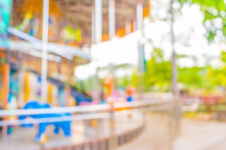 roundabout: blur image of roundabout in theme park for background usage. Stock Photo
