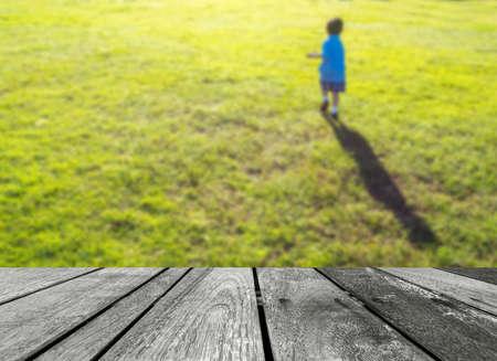 blurr: blurr shot of little boy running in the grass field .