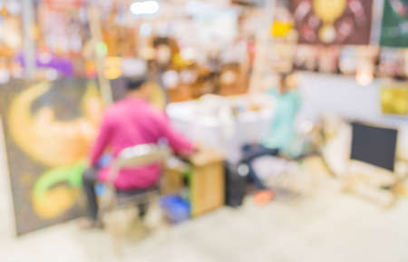 artist painting: image of blur artist painting in studio for background usage . Stock Photo