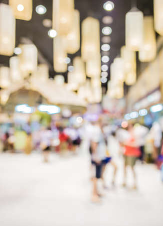 blurred people: Blurred image of people walking at shopping mall , blur background with bokeh .