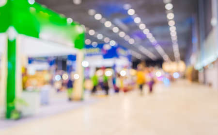 tradeshow: blurred image of shopping mall and people for background usage . Stock Photo