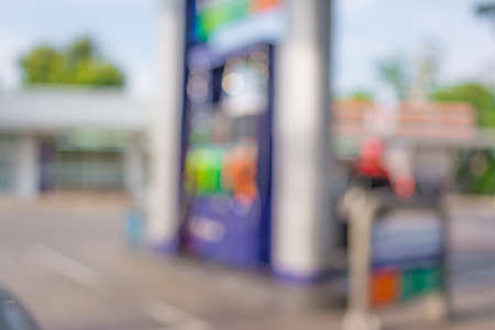 fill up: blur image of gas station on night time for background usage.