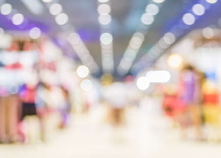 light show: blurred image of shopping mall and people for background usage . Stock Photo