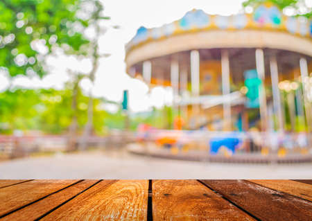 blur image of roundabout in theme park for background usage. 写真素材