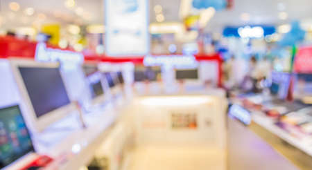 store: blur image of eletronic department store with bokeh for background usage .