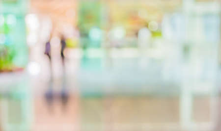 blur image of people in the lobby of a modern business center with a blurred background.