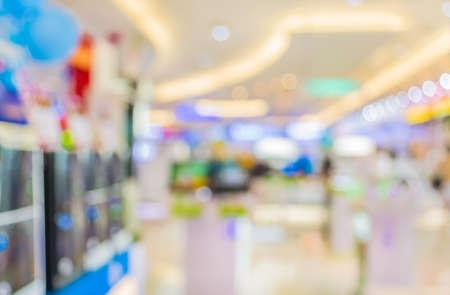 Blur beeld van elektronika warenhuis met bokeh voor achtergrond gebruik.