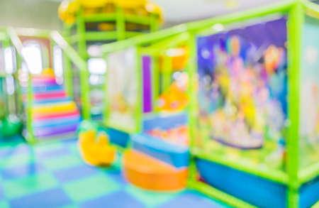 indoor background: blur colorful plastic balls on childrens playground .
