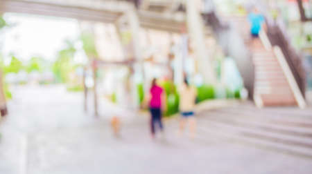 blur image of people at long  corridor with open space to the green garden with bokeh for background usage . Stock Photo