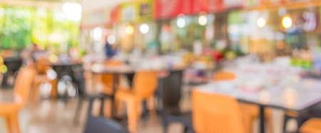 tiendas de comida: blur image of coffee shop with bokeh for background usage . Foto de archivo