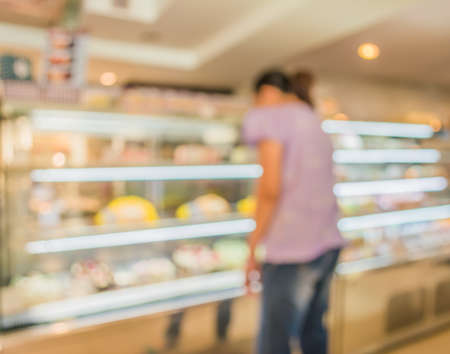 shop for: Blur image of people in bakery shop for background usage .