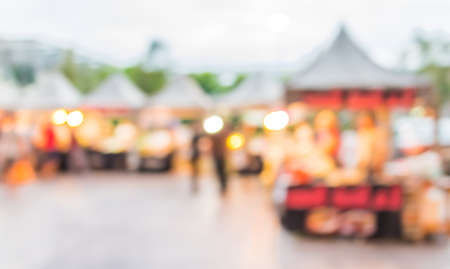blur image of food store in day festival for background usage.