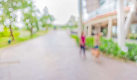 wagging: blur image of people wagging dog at open space to the green garden   for background usage .