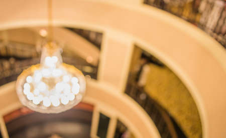 chandelier background: image of blur luxury chandelier and balcony in hall for background usage . Stock Photo