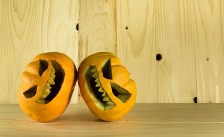jack o' lantern: image of halloween pumpkins with a Jack O Lantern on wooden background. Stock Photo