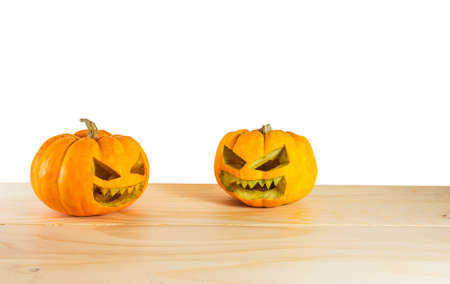 smiles teeth: image of orange halloween pumpkin on wooden table  isolated on white background. Stock Photo