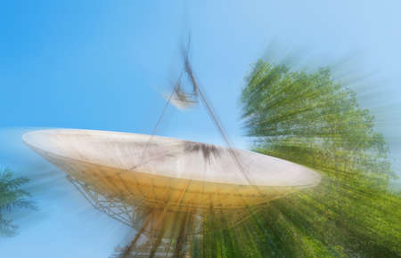 sattelite: image of large sattelite dish  and blue sky in background.