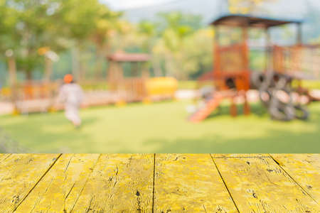 Defocused and blur image of children's playground at public park for background usage. Standard-Bild