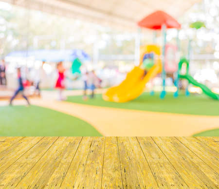Defocused and blur image of childrens playground at public park for background usage.