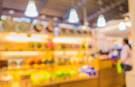 shop for: blur image of  people in bakery shop for background usage.