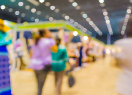 trade show: blurred image of people at trade show for background usage .