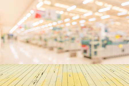 hypermarket: blurred image of shopping mall with no people for background usage .