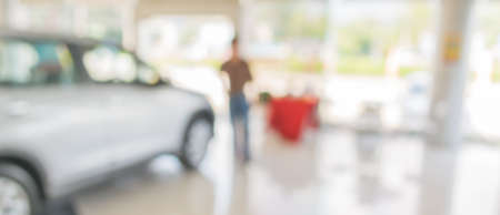 blur image of Commercially cars stand in show room of car shop for background usage. 写真素材