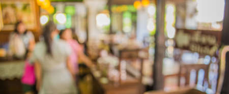 image of blurred bakery shelf in coffee shop for background usage .