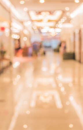 commodious: image of blur corridor and people in hotel lobby for background usage .