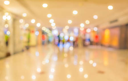 usage: blur image of Long empty corridor on night time with bokeh for background usage. Stock Photo