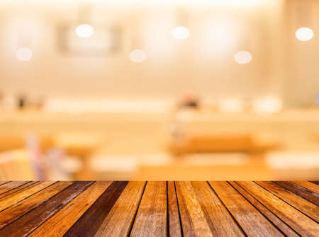 sushi: blur image of wood table and Abstract blurry sushi counter in vintage style decoration restaurant. Stock Photo