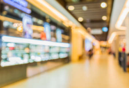 retail shopping: blurred image of shopping mall and people for background usage . Stock Photo
