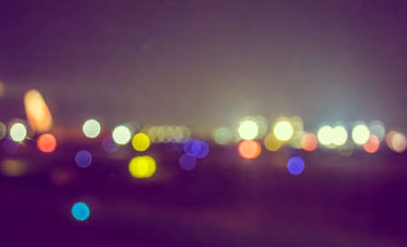 vintage tone blur image of runway in night time with bokeh for background usage.