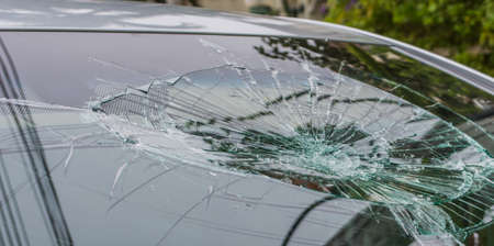 Selective focus image on Broken car windshield. Accident of car.