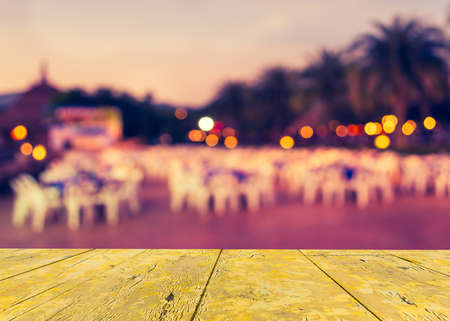 blur image of Tables and decoration prepared for an outdoor party on evening time for background usage. (vintage tone)