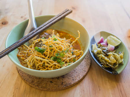 soi: image of Curried Noodle Soup (Khao soi) with thai style spice, Northern Thai style cuisine.