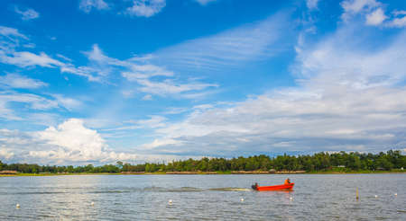 muskoka: image of lake and  speed boat on day time. Stock Photo