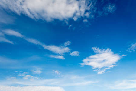 image of clear sky with white clouds on day time for background usage . Stock Photo
