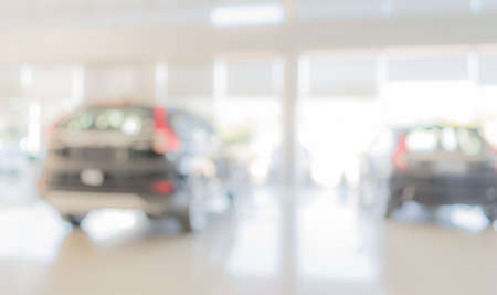 commercially: blur image of Commercially cars stand in show room of car shop for background usage .
