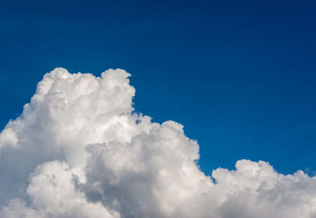 white cumulus clouds in the blue sky for background usage. Stock Photo