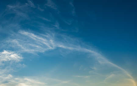 blue sky background with line of  white clouds.