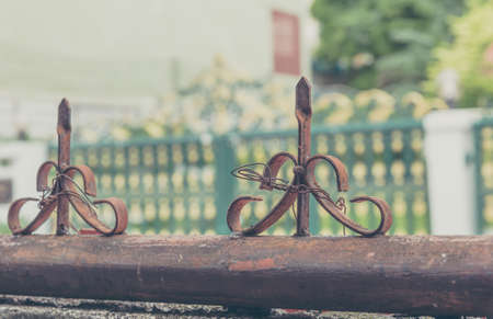 vintage tone image of old iron sharp tip on fence. Stock Photo