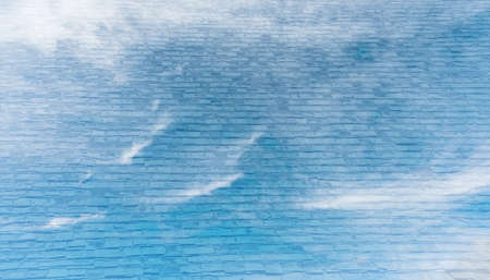 nimbi: image of blue sky and white clouds on day time with cement wall texture screen for background usage.(vintage tone) Stock Photo