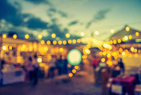vintage tone blur image of night festival on street blurred background with bokeh . Stock Photo