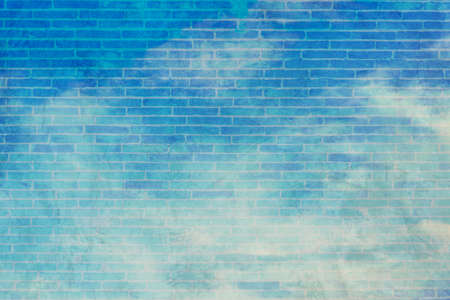 image of blue sky and white clouds on day time with cement wall texture screen for background usage.(vintage tone) Stock Photo