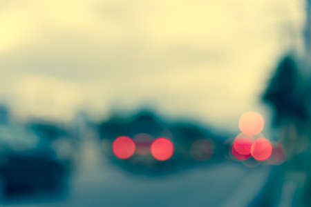 vintage tone image of blur street bokeh with colorful lights in evening time for background usage . Stock Photo