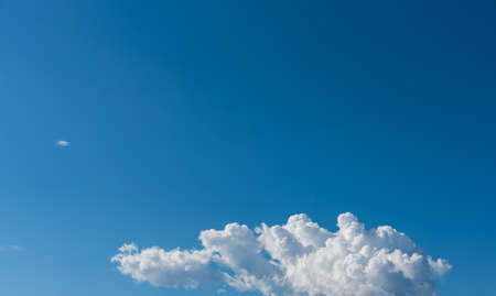 nebulosity: image of blue sky and white clouds on day time for background usage.
